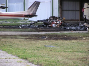 Charred remains of a crash where pilot and friend survived.